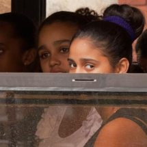 Three girls on a bus (Havana)