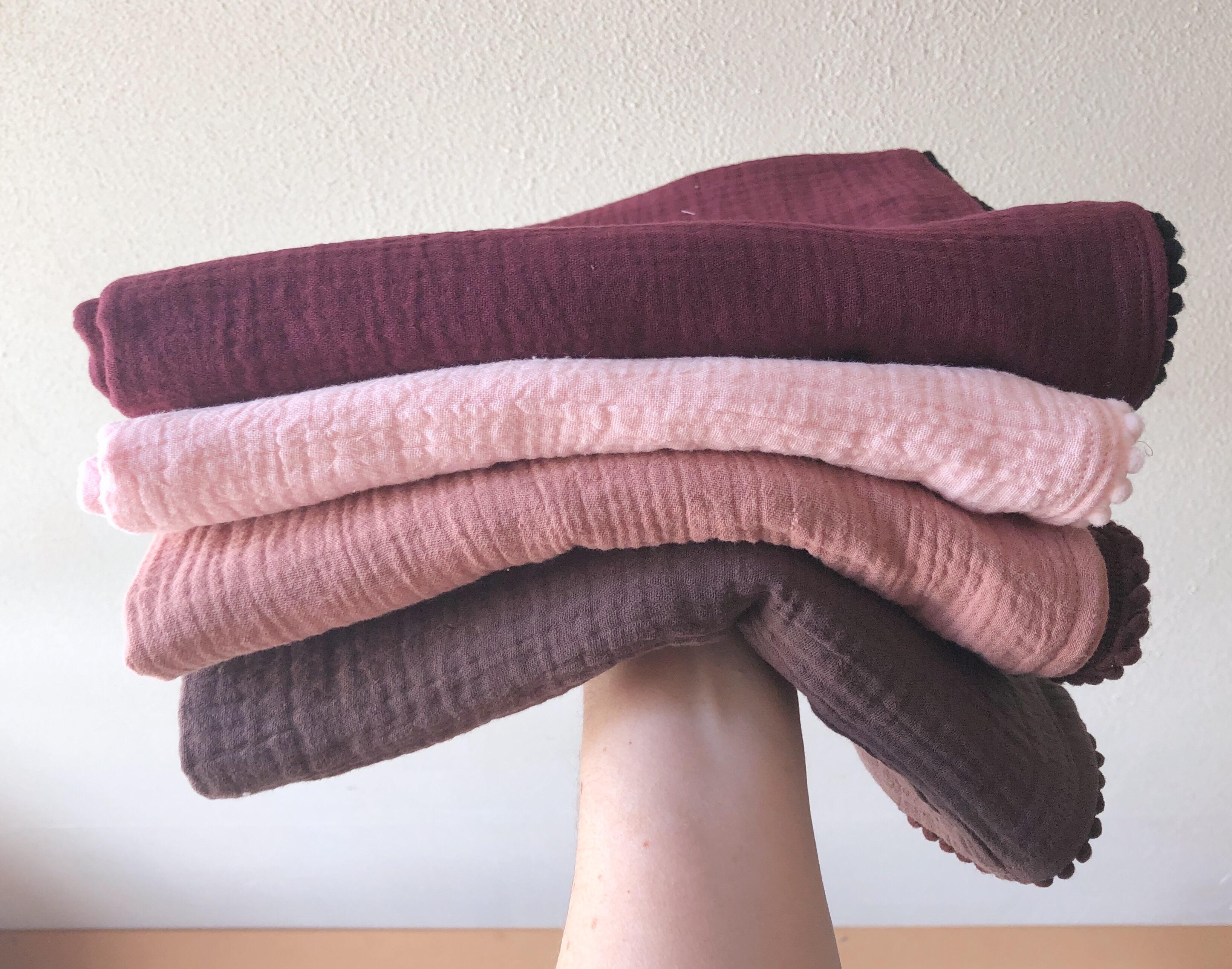 Zachte hydrofiele doeken met een schattig pompom randje