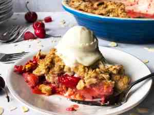 Rhubarb Cherry Strawberry Crisp with Melting Ice Cream Close-up