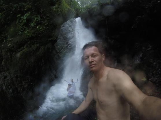 Friends under waterfall.