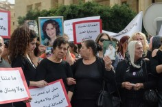 Mothers and loved ones of victims of domestic violence at a anti-domestic violence protest organize by KAFA last summer. Taken by Cynthia Ghoussoub