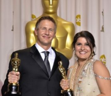 """Winners for Best Documentary Shor """"Saving Face,"""" Daniel Junge and Sharmeen Obaid-Chinoy poses with the trophy in the press room at the 84th Annual Academy Awards on February 26, 2012 in Hollywood, California. AFP PHOTO / Joe KLAMAR ===NO INTERNET, EMBARGOED FROM INTERNET AND TELEVISION USAGE UNTIL THE CONCLUSION OF THE OSCARS TELECAST=== (Photo credit should read JOE KLAMAR/AFP/Getty Images)"""