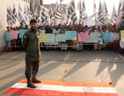 LAHORE, PAKISTAN, NOV 18: Supporters of Jamat-ud-Dawa are protesting against India Government during demonstration at Chuburji Chowk in Lahore on Friday, November 18,  2011.(Babar Shah/PPI Images).
