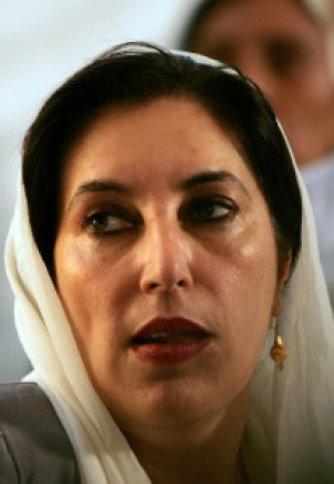 "Former Pakistani premier Benazir Bhutto addresses media representatives at a press conference in Karachi, 19 October 2007. Bhutto strongly condemned bomb attacks on her homecoming parade in Karachi, saying that her followers had made the ""ultimate sacrifice"" for democracy. Bhutto escape unhurt, a suicide bomber attack that killed at least 133 people in an attempt to assassinate her during a homecoming parade. AFP PHOTO/CARL DE SOUZA"