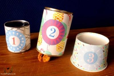 Intelligenzspielzeug aus Konservendosen