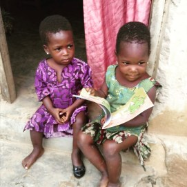 Children learning in Togo with the help of Fly for Life's sustainable tourism and organic farming programs