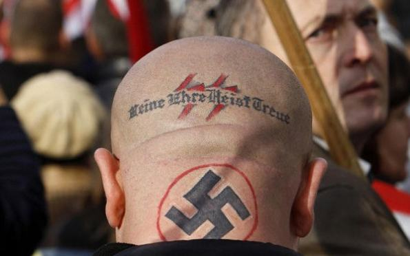 "Jobbik supporter--""Honor is my loyalty"" The Telegraph / Photo Reuters"