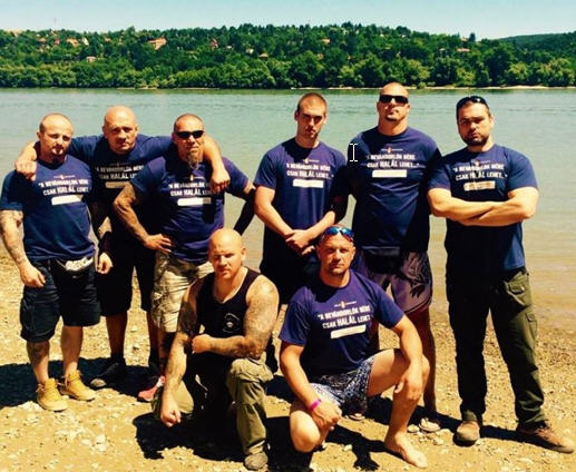 Members of a radical far-right group in T-shirt promising death to the immigrants