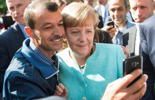 The much criticized selfie with a Syrian refugee