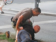 Plain-clothes cop arrests anti-gay demonstrator at the Budapest Pride parade (7/5/2008).