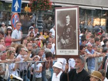 Man marching in Saint Stephen's Day procession with portrait of interwar head of state Miklós Horthy (8/20/2008).