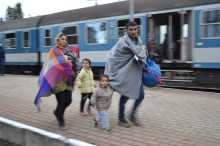 Migrants walk down platform at Hegyeshalom railway station.