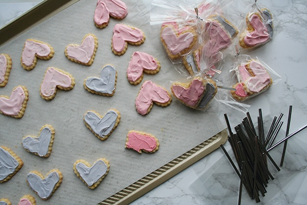 pink and purple ombre frosted heart shaped sables on a cookie sheet and individually packaged for Valentine's Day