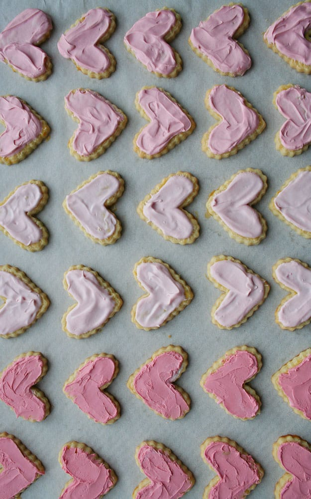 pink ombre frosted heart shaped sables lined up in neat rows for Valentine's Day