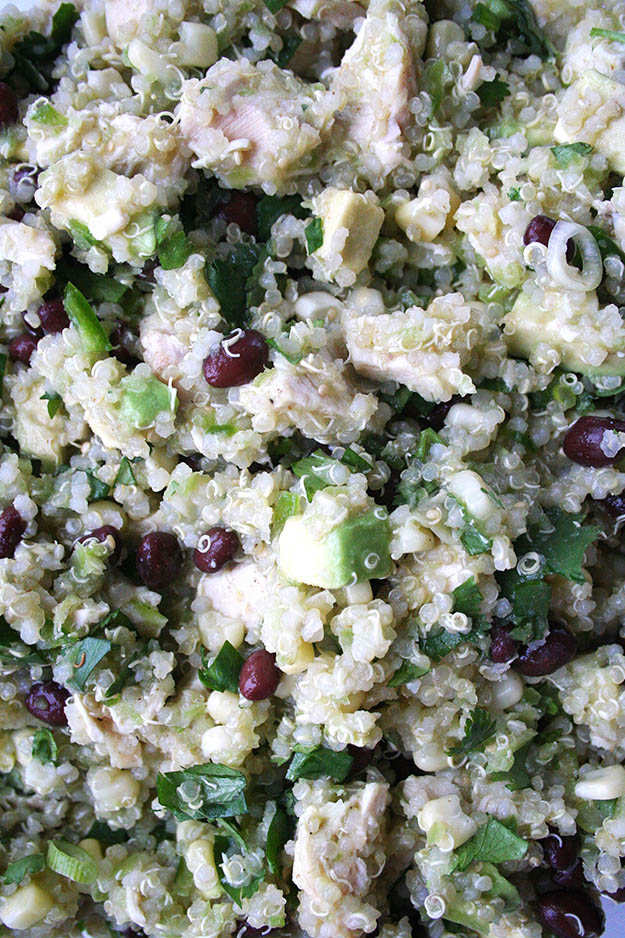 zoomed in on the ingredients of chicken avocado quinoa salad with tomatillo dressing