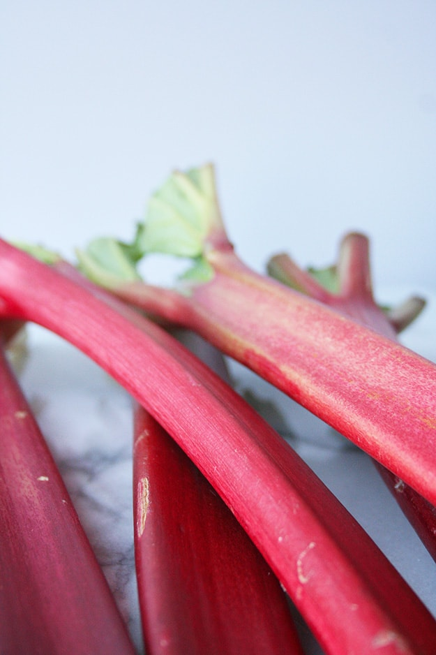 a close of of raw rhubarb ready to be made into rhubarb ginger muffins