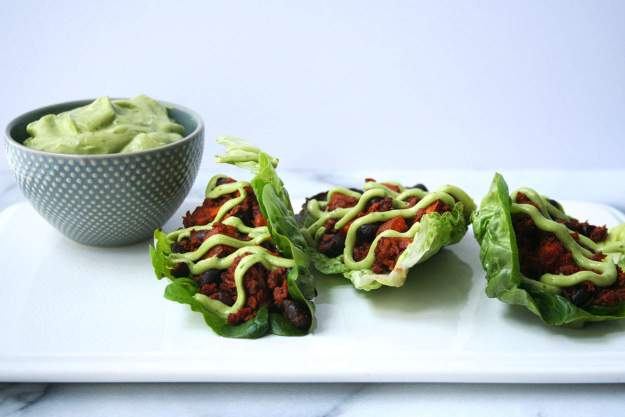 Soy Chorizo Lettuce Wraps topped with a Creamy Avocado-Lime Sauce | hungrybynature.com