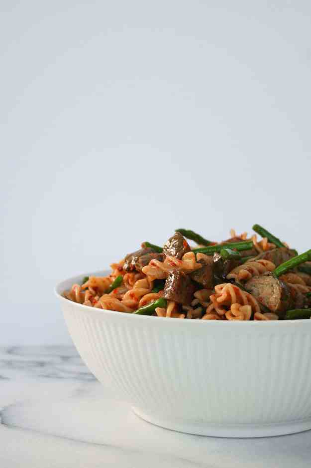 A simple sun dried tomato and pesto chicken sausage pasta salad is what's on the table for dinner tonight!   hungrybynature.com