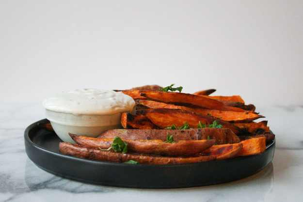 A big plate of BAKED sweet potato fries is what's for dinner tonight! And don't forget the creamy tahini dip! | hungrybynature.com