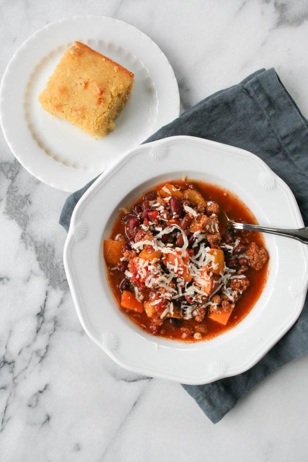 crock pot turkey chili in bowl with cornbread