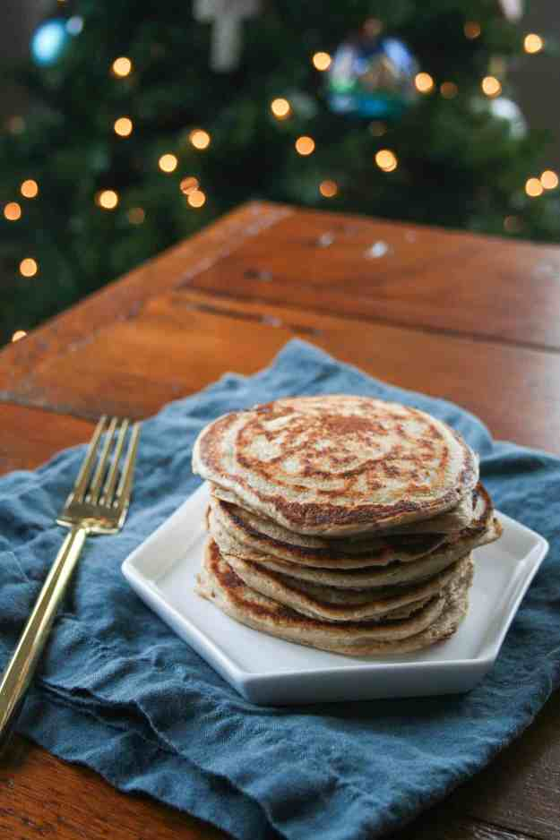A big stack of protein packed (14 grams per serving!) gingerbread pancakes is the most festive breakfast to have on Christmas morning! | hungrybynature.com