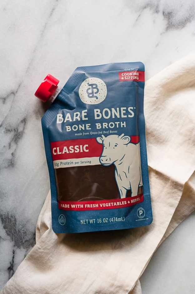 pouch of bare bones bone broth classic flavor sitting on a marble counter
