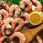 overhead shot of sheet pan shrimp and green beans with a lemon wedge