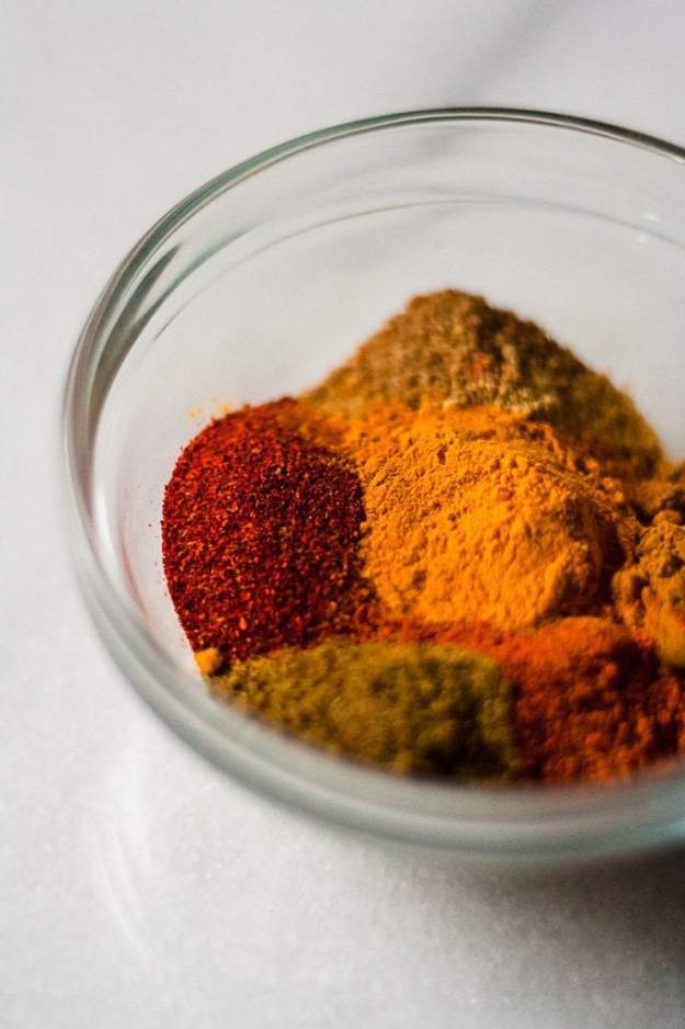 bowl of spices for sheet pan moroccan chicken
