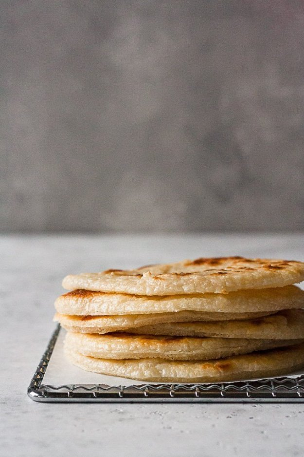 almond flour tortillas stacked on cooling rack