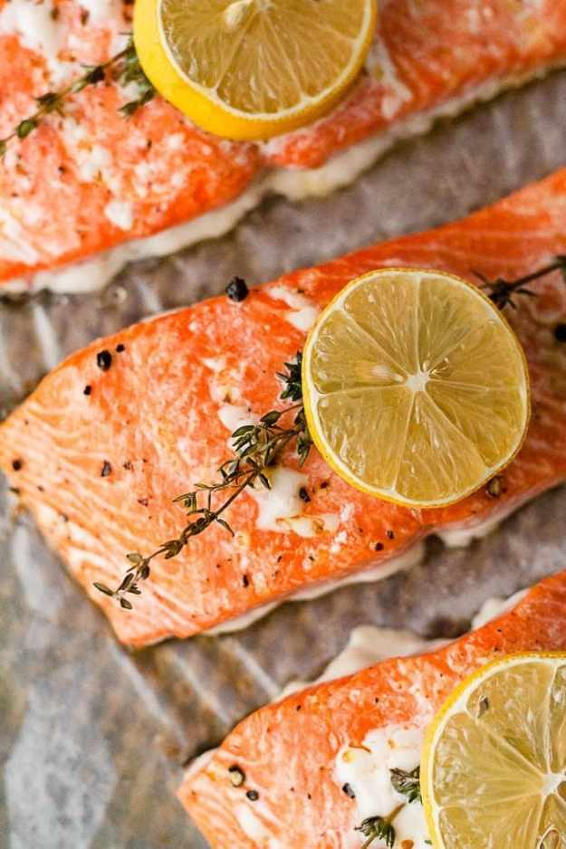overhead close up shot of whole30 lemon salmon recipe on a sheet pan