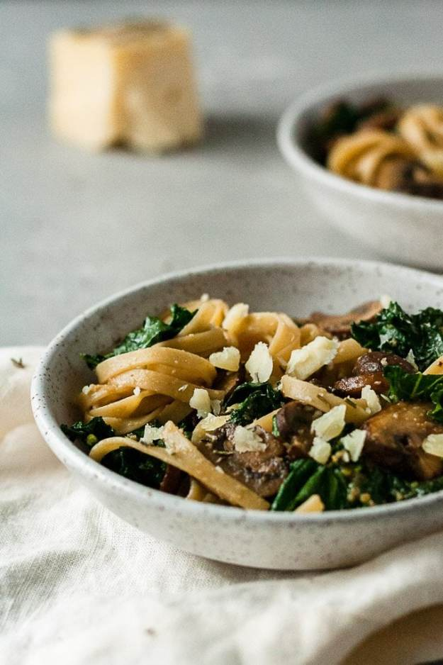 miso mushrooms date night pasta in two bowls with cheese