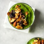creamy green smoothie topped with granola