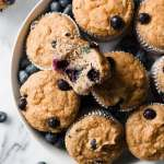 gluten free blueberry muffins in a bowl with bite taken out