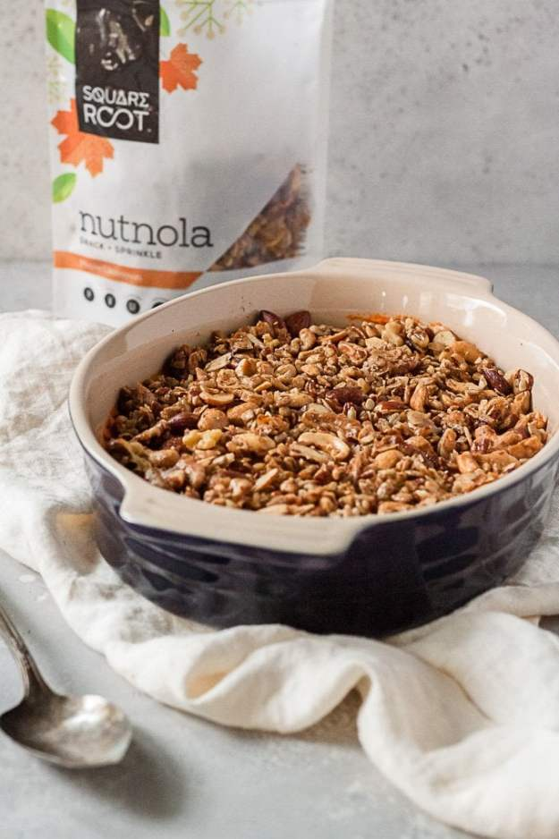 sweet potato casserole with square root nutnola topping and bag of square root nutnola in background