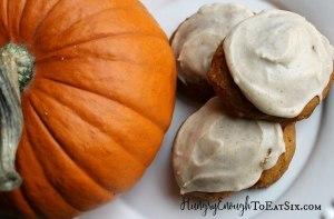 These soft, spiced pumpkin cookies are topped with a sweet glaze frosting!