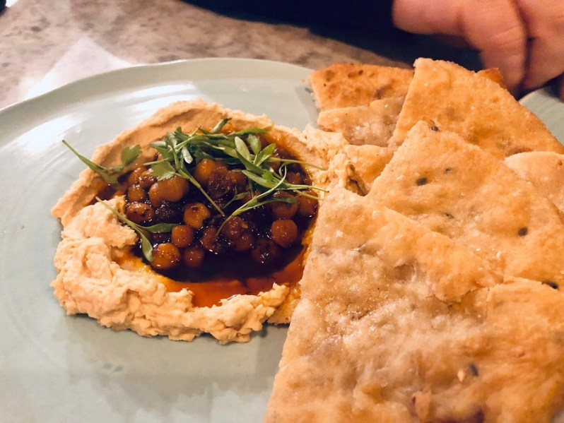Hummus and chickpeas with flatbread at Rocket and Ruby restaurant Liverpool