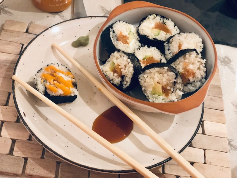 homemade salmon and avocado sushi roll with cream cheese and nori seaweed roll