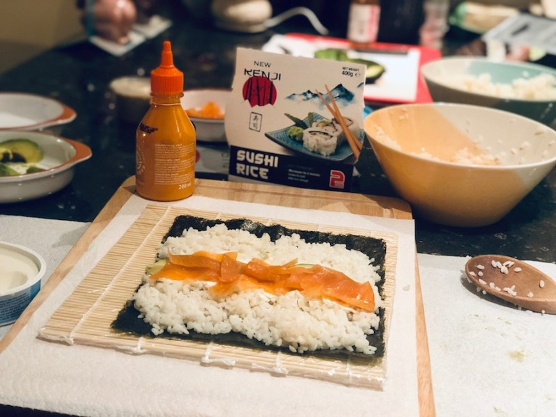 how to roll sushi with a bamboo rolling mat