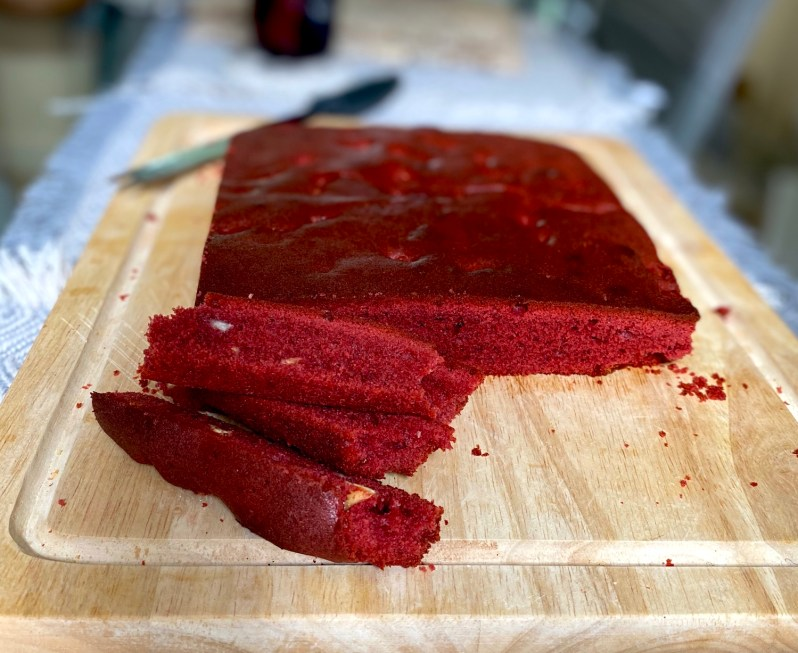 the ingredients you need for a red velvet cake or cookie bar tray bake recipe