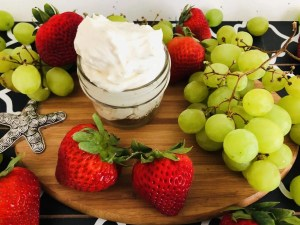 A jar of lightened up fruit dip and some fresh fruit