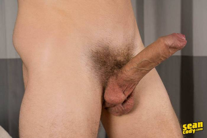 A hard uncut cock seen from the site in a solo jerk off shoot