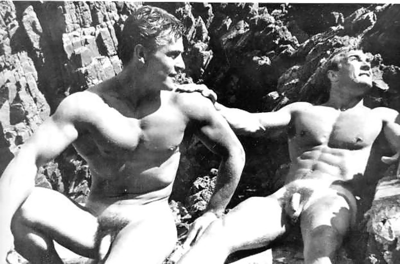 Two naked physique models with their uncut cocks out