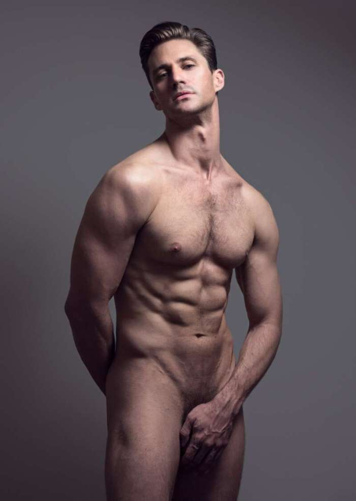 Nicholas Cunningham posing nude and hiding his manhood