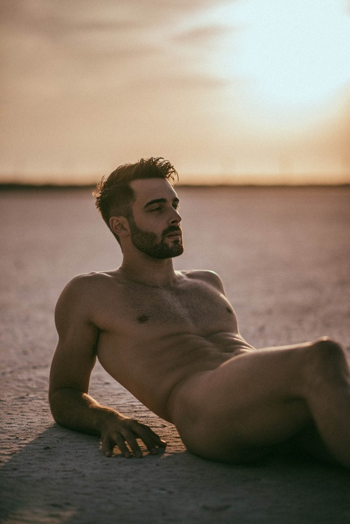 Handsome male model Vivien Mistral naked at the beach