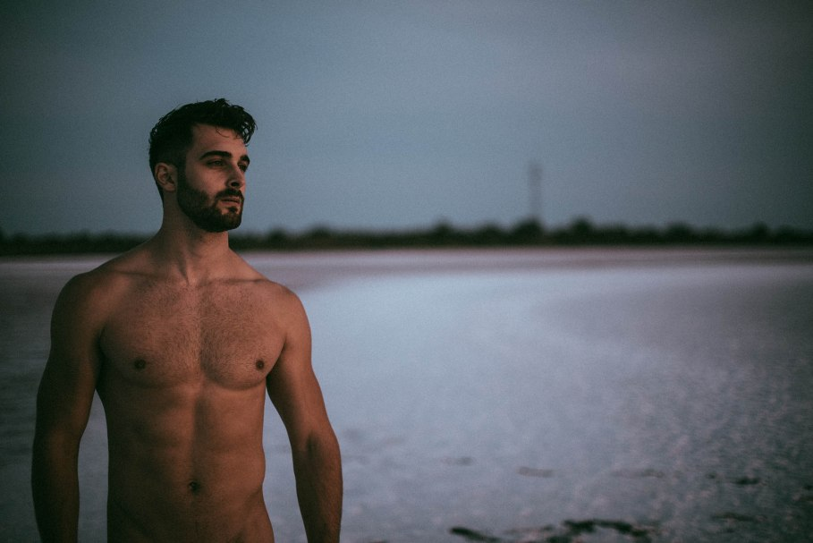hairy and handsome male model Vivien Mistral at the beach
