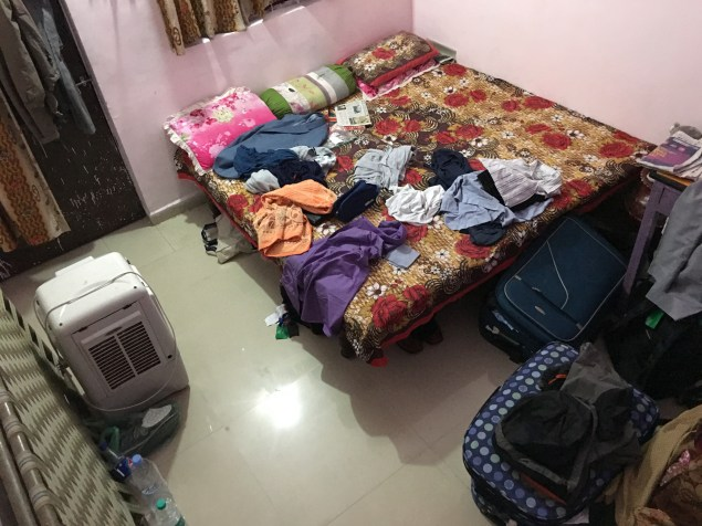 Busy unpacking in the bedroom.