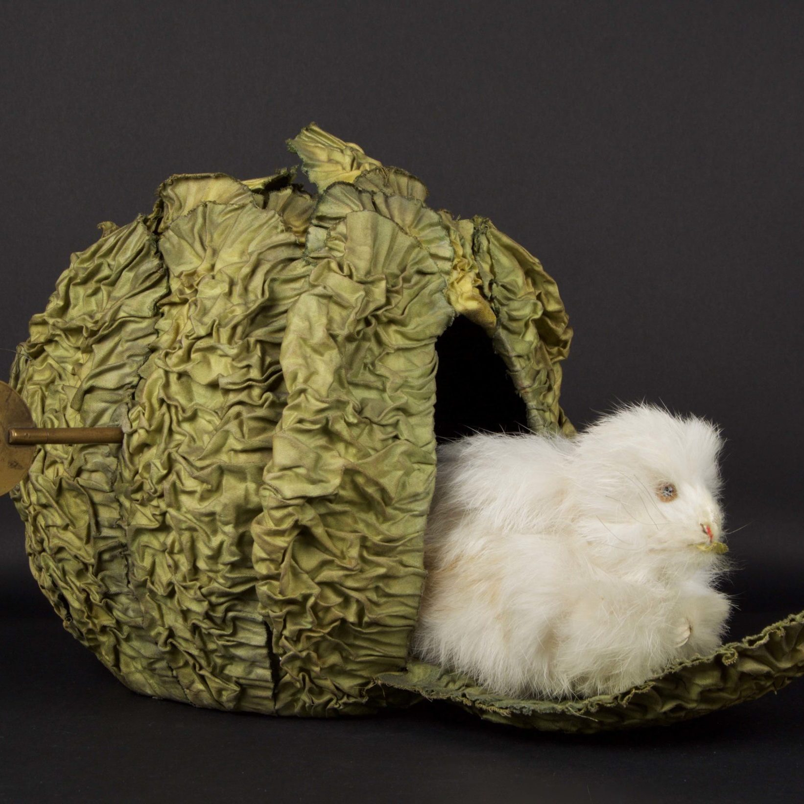 Musical box in the shape of a rabbit in a cabbage