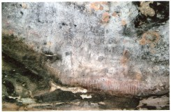 """Photo Credit: Jim Mitchell 2015. Annotation by Brian Laut on reverse side of photograph: """"There are four stencils of axe heads (all different). Must have been a 'Show and tell' Cave! The numerous band of white stripes have me intrigued - I have no reason for it."""""""