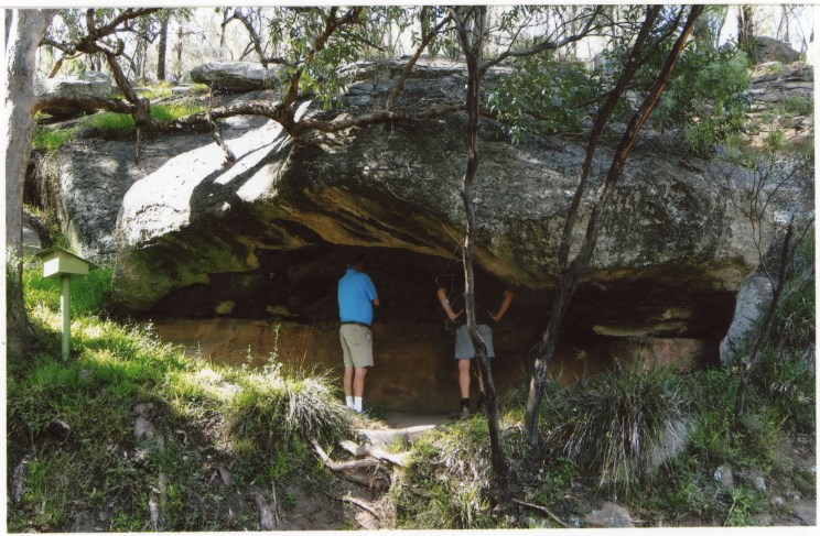 """Photo Credit: Jim Mitchell 2015. Annotation by Brian Laut on reverse side of photograph: """"Cave with axe head stencils and bands of white stripes."""""""