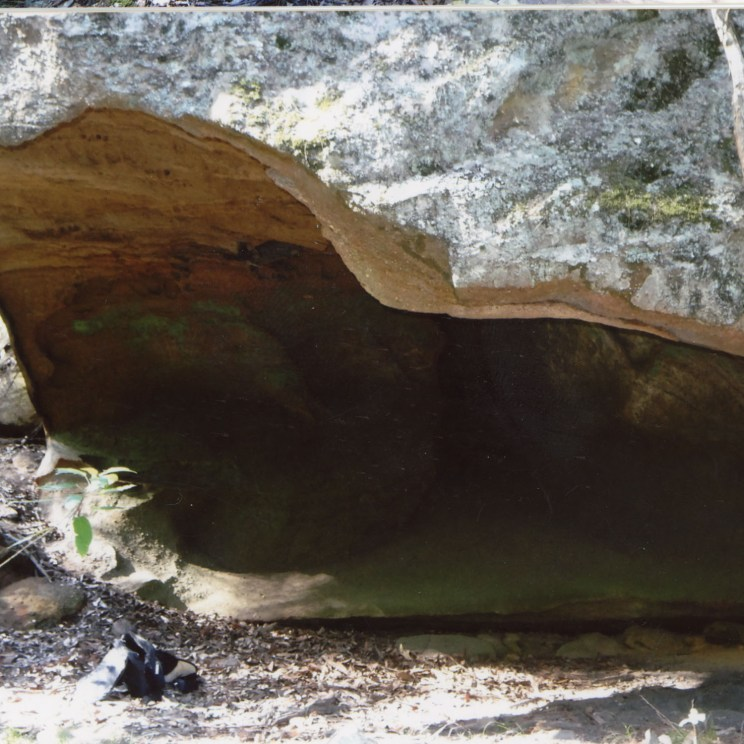 "Photo Credit: Jim Mitchell 2015. Annotation by Brian Laut: ""Cave right down in bed of creek, cr(eek) shows signs of flooding - sure there has been more paintings in this, but have been removed by numerous flooding."""